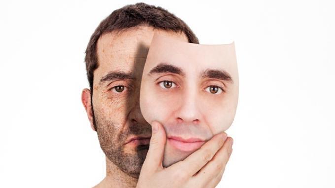 homme derriere un masque represente depression masquée - psychologue paris